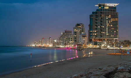 TEL AVIV, ISRAEL - JANUARY 22: The beach and the hotels in Tel Aviv on the Mediterranean coast in the winter late evening in Tel Aviv, Israel on January 22, 2016