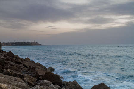 Seascape, view of the Mediterranean sea in winter cloudy evening from promenade of Tel Aviv, Israel