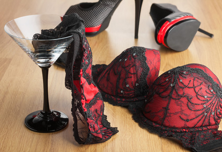 Photo pour Panties in a martini glass on the background of  shoes and  bra, can be used as a background - image libre de droit