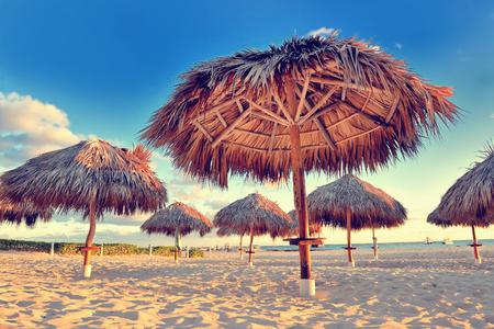 Foto de Amazing tropical holidays. Sun umbrellas on the beach. Tropical paradise. Caribbean. Punta Cana. Dominican Republic - Imagen libre de derechos