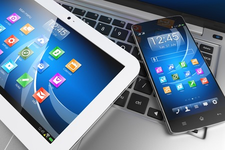 Foto per Mobile devices. Tablet PC, smartphone on laptop, technology concept. 3D - Immagine Royalty Free