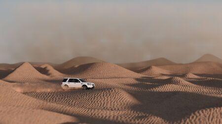Foto de Desert Safari in Dubai. White suv at sunset. Off road travel theme landscape - Imagen libre de derechos