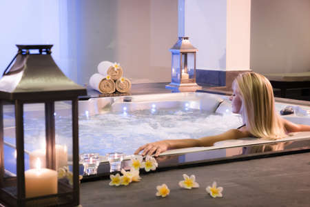 Photo pour Spa theme .The girl relaxes in a jacuzzi - image libre de droit