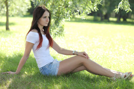 Photo for Sexy erotic girl with mini skirt on green grass - Royalty Free Image