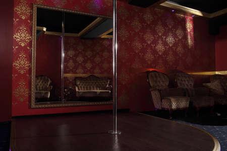 Photo pour Pylon with striptease club against the background of a large mirror - image libre de droit