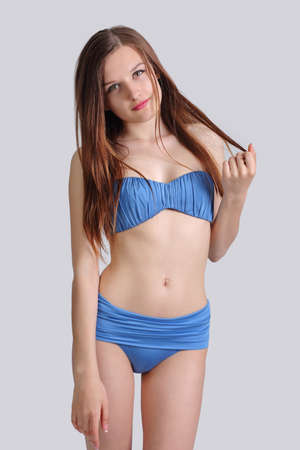 Photo for young cute girl posing in bikini, on gray background - Royalty Free Image