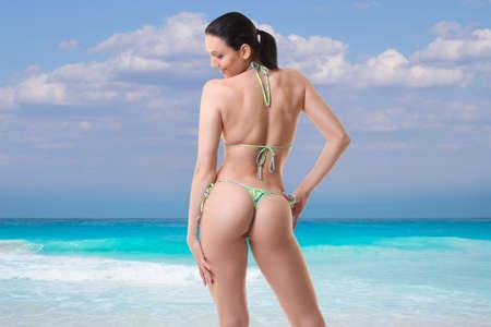 Foto de young girl in bikini is resting on the sea - Imagen libre de derechos