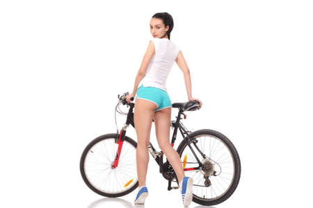 Photo pour young athletic and slim girl on a bicycle - image libre de droit