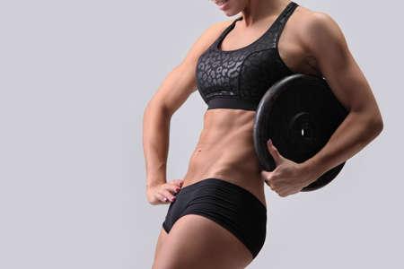 Foto de young beautiful fitness girl with muscular sexy body - Imagen libre de derechos