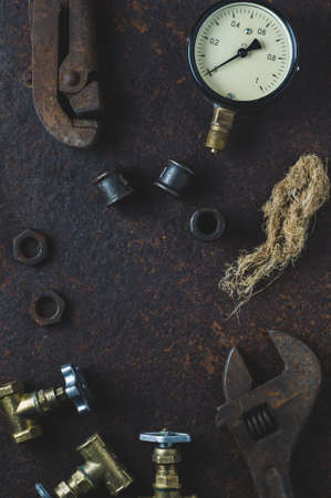 Photo for Old wrenches and water gates on a rusty iron background - Royalty Free Image
