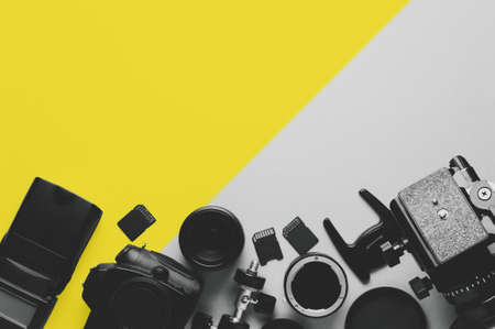 Photo for Digital camera, lenses and equipment of the photographer on a grey background - Royalty Free Image