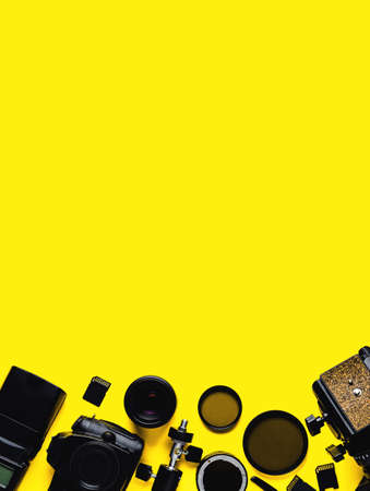 Photo for Digital camera, lenses and equipment of the photographer on a yellow background - Royalty Free Image