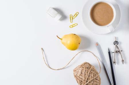 Foto de Cup of coffee with milk and creative accessories on white background - Imagen libre de derechos