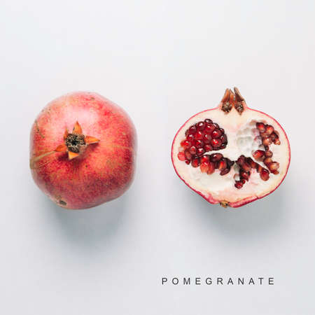 Photo pour Red pomegranate isolated on white background. Flat lay and top view - image libre de droit