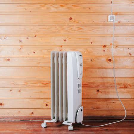 Photo pour Heater against a wooden wall. Space for text or design - image libre de droit