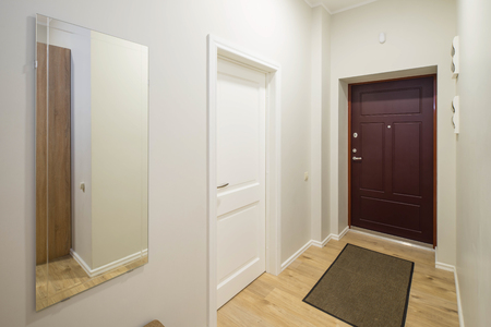 Foto de Entrance door in a modern interior with light walls. - Imagen libre de derechos