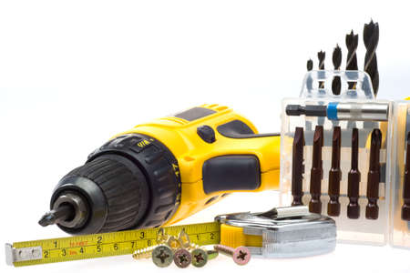 Photo pour Electric screwdriver and accompanying equipment on a white background - image libre de droit