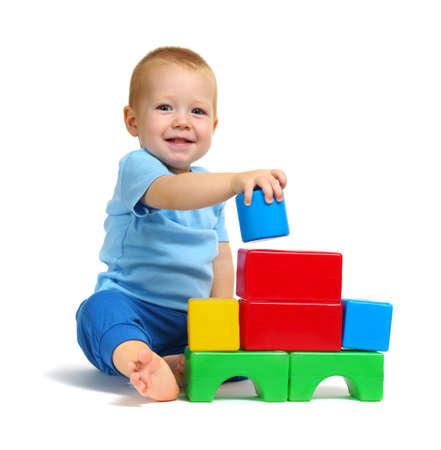 Foto de Little boy playing toy isolated on white background - Imagen libre de derechos