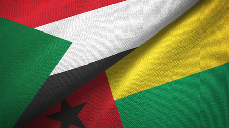 Sudan and Guinea-Bissau two flags textile cloth, fabric texture