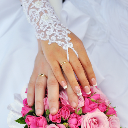 Photo for Closeup of a bride and groom hands - Royalty Free Image