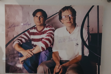 Photo for Prague, Czech Republic - August 28, 2018: Signed portrait of Steve Jobs and Bill Gates on exhibit inside Apple Museum in Prague, the largest private collection of Apple products around the world. - Royalty Free Image