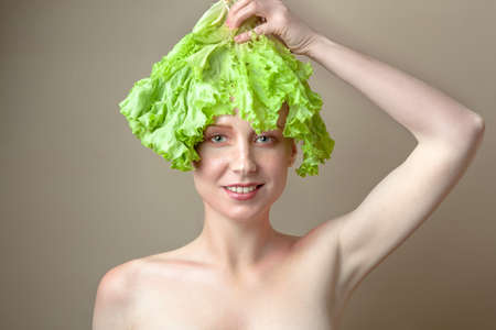 Photo for Surprised model girl with Lettuce hair style. Beautiful happy young woman with green vegetables on her head. Healthy food concept, diet, vegetarian food. Dieting concept. Weight loss. Vegan food - Royalty Free Image