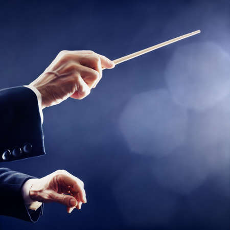 Photo for Music conductor hands orchestra conducting - Royalty Free Image