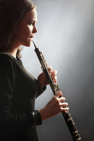 Photo for Oboe Oboist playing classical music instrument - Royalty Free Image