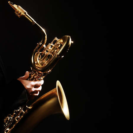 Photo for Saxophone player Jazz Music Instrument Baritone Sax isolated on black - Royalty Free Image
