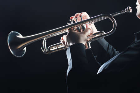 Photo for Trumpet player. Trumpeter hands playing wind musical instrument - Royalty Free Image