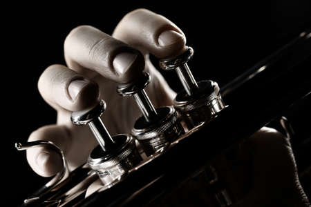 Photo for Trumpet player. Trumpeter hands playing brass musical instrument close up - Royalty Free Image