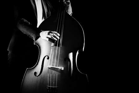 Photo for Double bass player playing contrabass musical instrument. Classical musician - Royalty Free Image