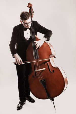 Photo for Double bass player playing contrabass Classical musician - Royalty Free Image