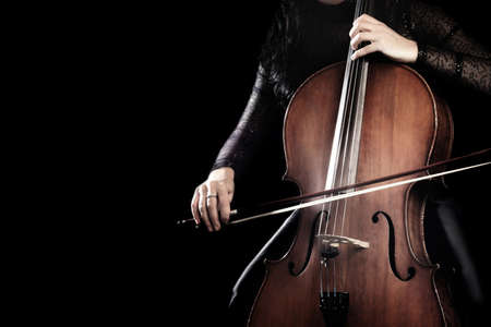 Photo for Cello player. Cellist hands playing cello with bow orchestra musical instrument close up - Royalty Free Image