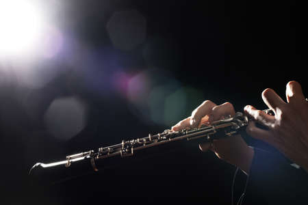 Photo for Oboe player hands. Woodwind classical musical instruments closeup - Royalty Free Image