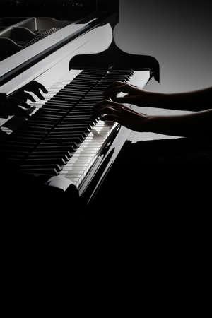 Photo pour Piano player. Pianist hands playing piano keyboard. Music instrument closeup grand piano keys - image libre de droit