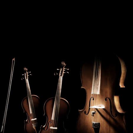 Foto de String instruments isolated. Violin, viola and cello musical instrument of orchestra. Classical music instruments isolated on black background - Imagen libre de derechos