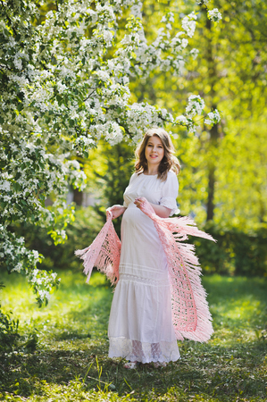 Photo for Happy woman on a background of awakening of the spring garden. - Royalty Free Image