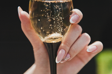Photo for A glass of champagne in his hand. - Royalty Free Image