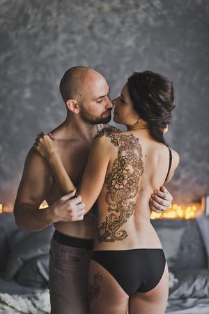 Photo pour Man removes clothes from the girls. - image libre de droit