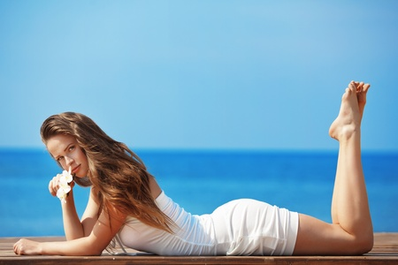Photo for Portrait of very beautiful youg girl posing at the summer beach - Royalty Free Image