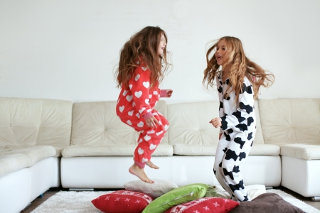 Foto per Children in soft warm pajamas playing at home - Immagine Royalty Free
