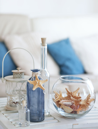 Photo for Idea of interior decoration with starfishes and glass bottles - Royalty Free Image