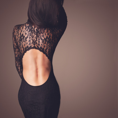 Photo pour Fashion photo of beautiful lady dressed in evening black lace dress - image libre de droit