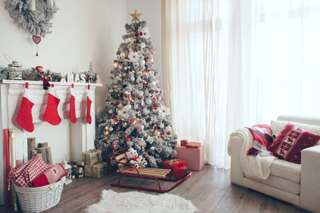 Photo pour Beautiful holdiay decorated room with Christmas tree with presents under it - image libre de droit