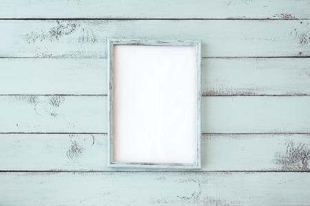 Photo pour Wooden photo frame on mint shabby chic background - image libre de droit