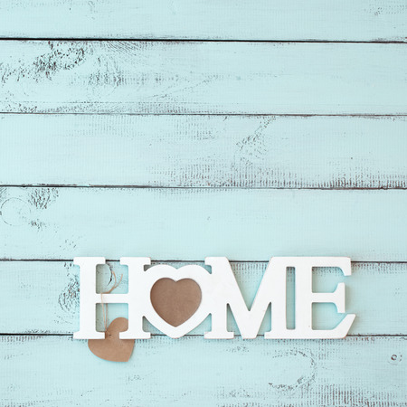 Photo for Painted timber wall decorated with shabby chic wooden letters Home - Royalty Free Image