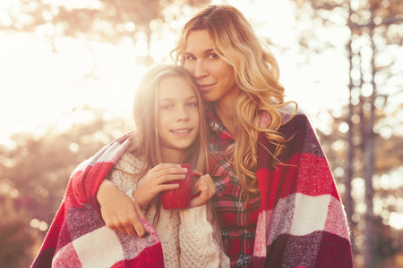 Photo pour Mom and her 9 years old daughter spending weekend in the autumn forest together. Mother and child relations. - image libre de droit