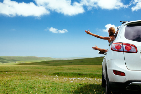 Photo for Car in the field on green grass and blue skies - Royalty Free Image