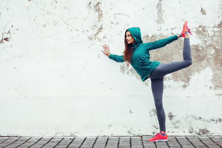 Photo for Fitness hipster girl in fashion sportswear doing yoga fitness exercise in the street, outdoor sports, urban style - Royalty Free Image